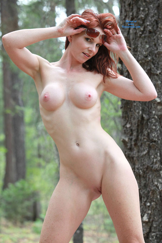 red head sunglasses in forest.jpg