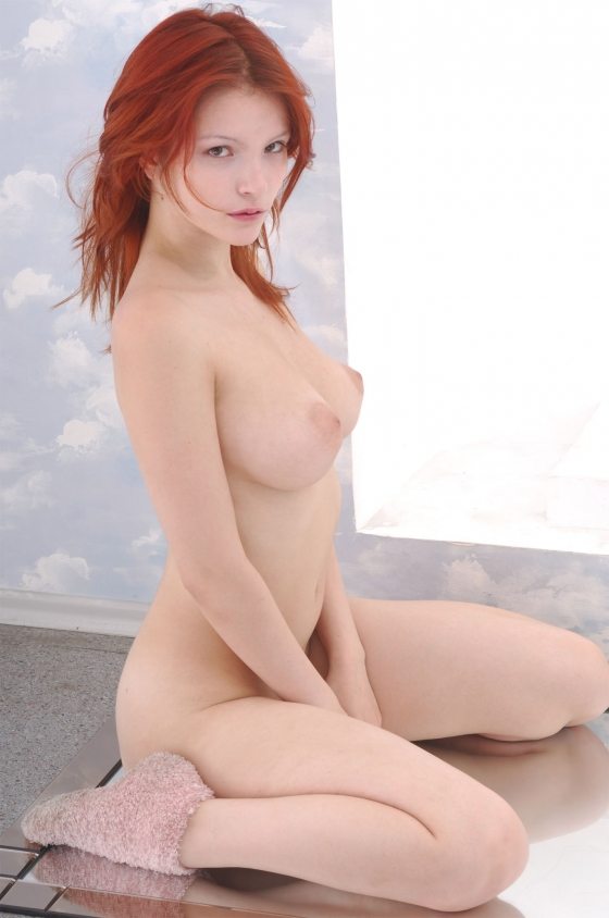 red head on her fuzzy shoes.jpg