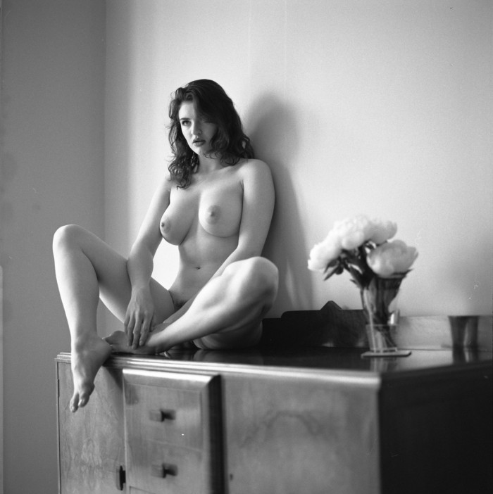 Nude girl on a dresser with flowers.jpg