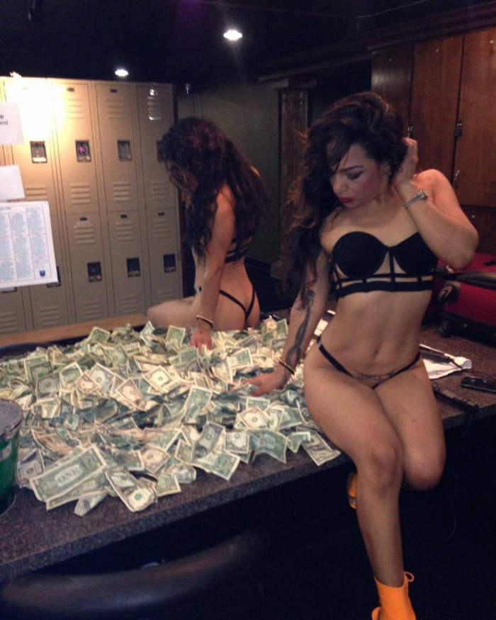 Sitting on a pile of cash.jpg