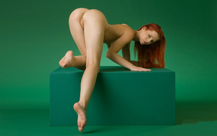 green room red head on a green cube.jpg
