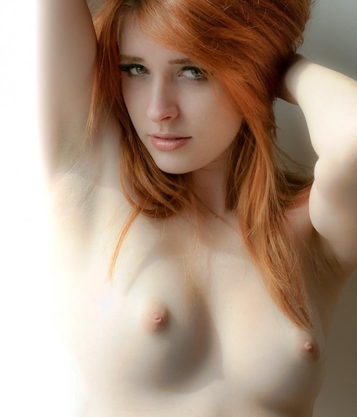 tiny tits on a red head.jpg