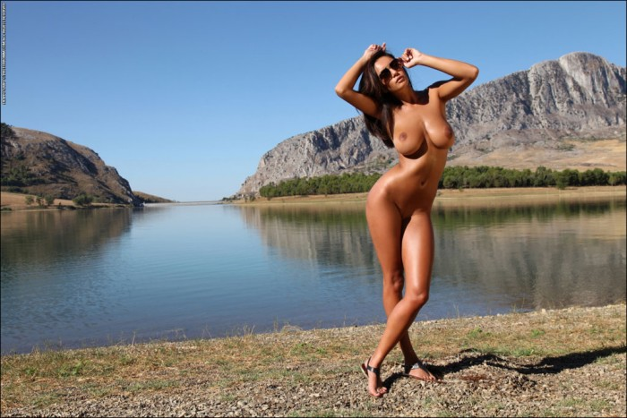 Nude and well tanned woman and massive mountains.jpg