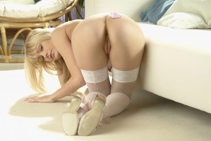 blonde from behind by bed.jpg