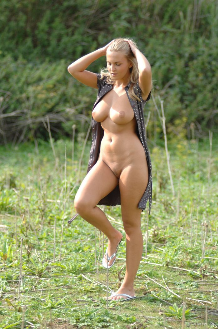 busty blonde getting out of her dress.jpg