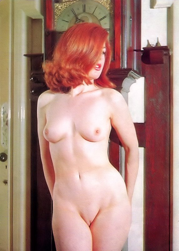 red head by red clock.jpg