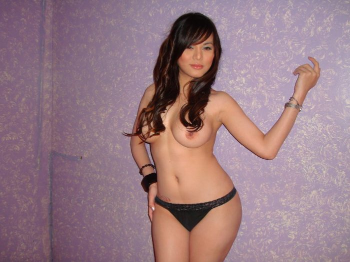 sexy asian in a purple room.jpg