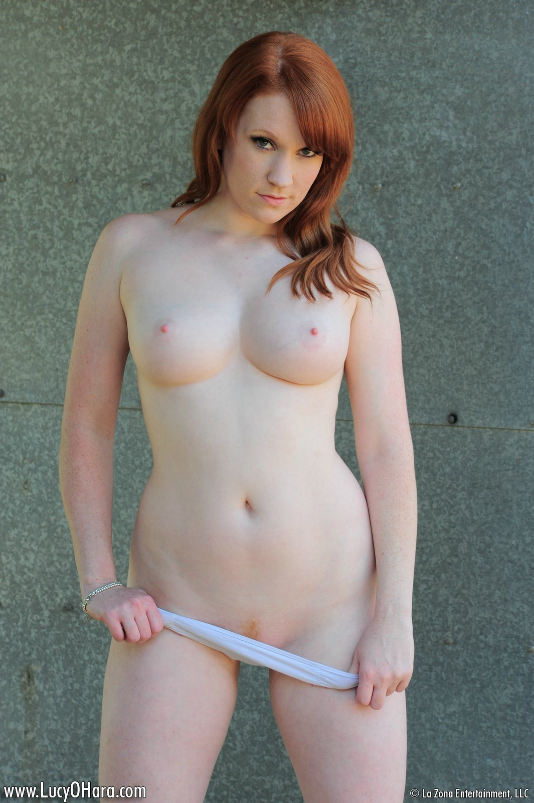 Lucy O'Hara – pulling down her white cotton panties.jpg