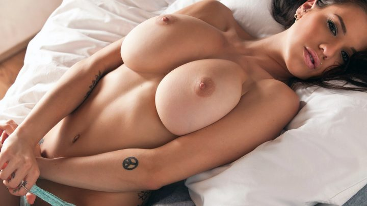 Tess Taylor has massive tits and a peace tattoo.jpg