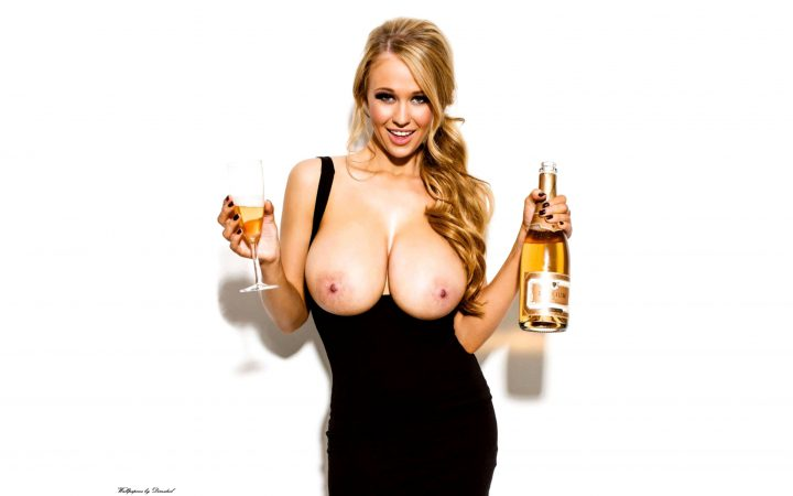 Champagne with her tits out.jpg