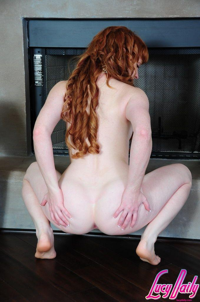 Lucy O'Hara squating to spread her ass.jpg