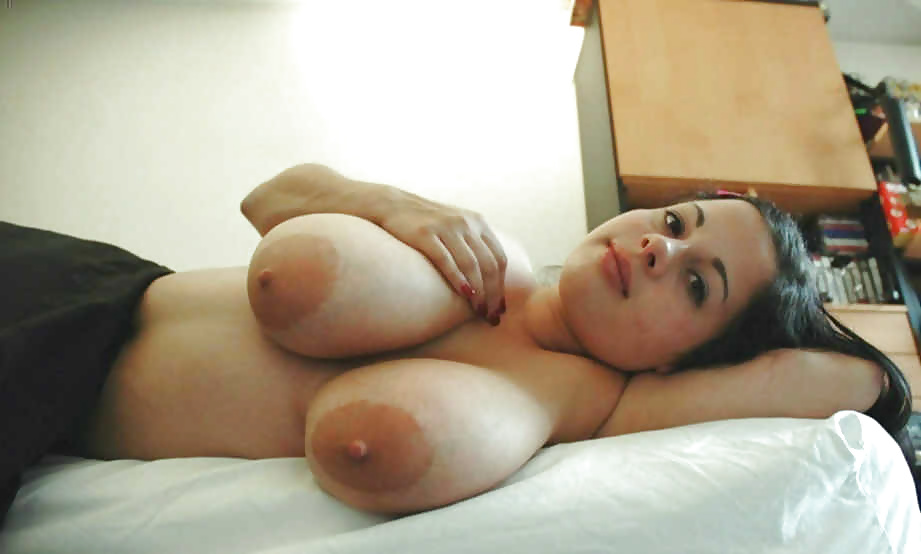 large breasts on her side.jpg