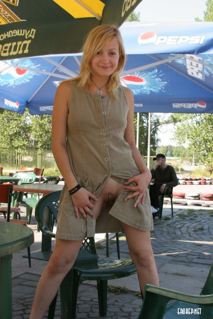 flashing her shaved pussy at a fair.jpg