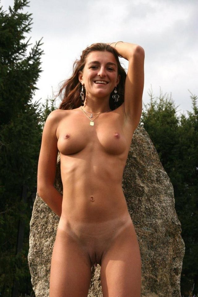 happy nude leaning on a rock.jpg