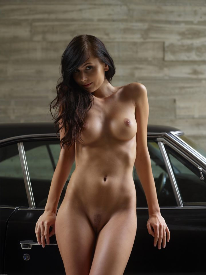 nude woman by classic car.jpg