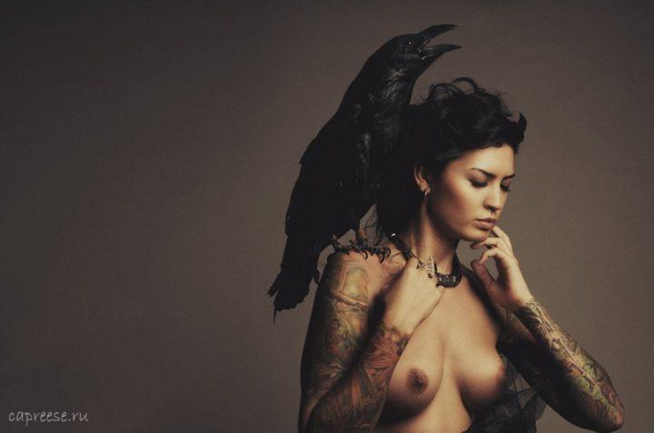 topless woman with a raven on her sholder.jpg