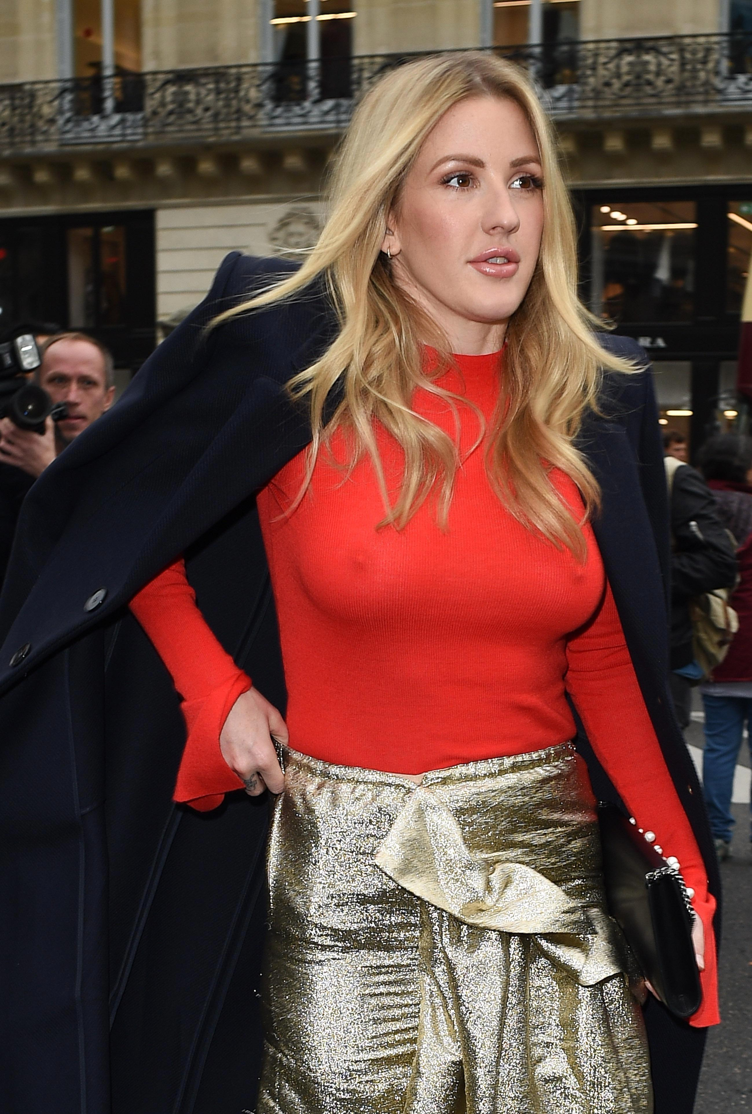 Ellie Goulding in a red see through top