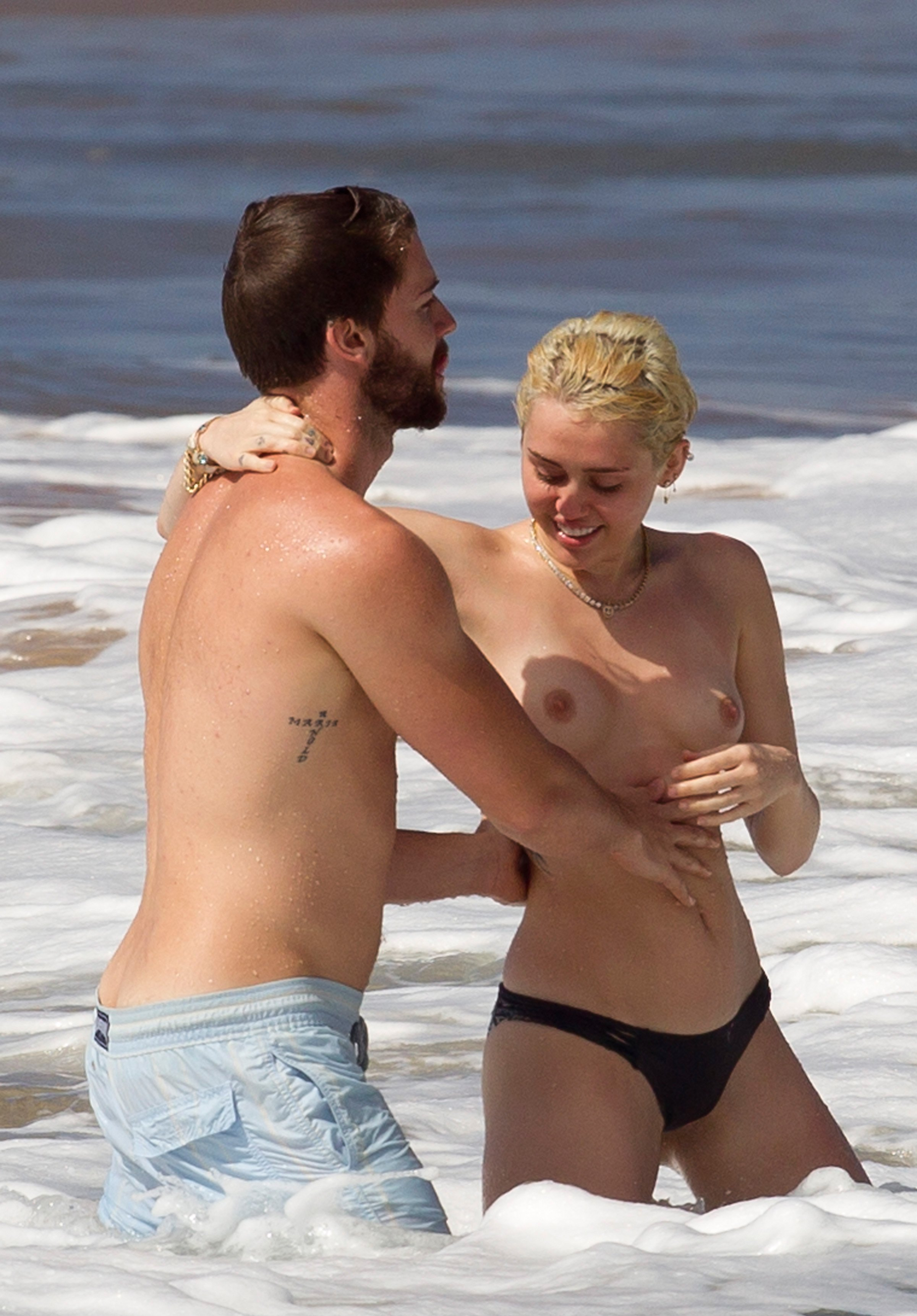 Miley Cyrus – Topless in Hawaii  (26)
