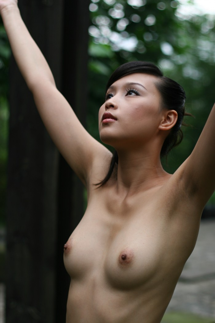 Asian with her arms up.jpg