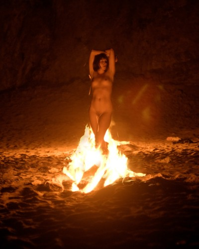 nude woman on fire