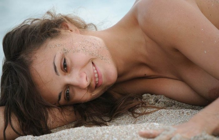sandy beach woman 1 700x449 sandy girl
