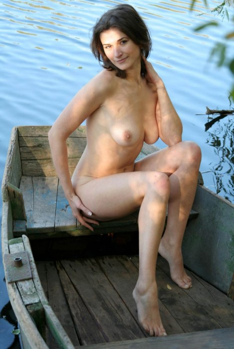naked women in row boats