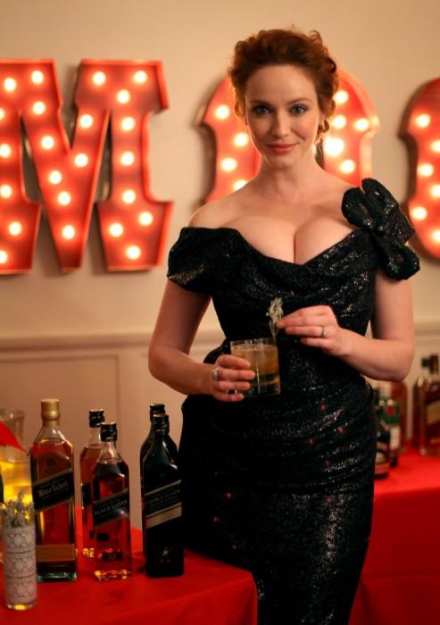 christina hendricks boobs 2 493x700 christina hendricks enjoys a drink