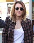 Miley Cyrus WhiteTLunch 2 121x150 Miley Cyrus Goes Braless in a white shirt
