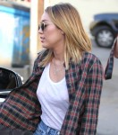 Miley Cyrus WhiteTLunch 20 132x150 Miley Cyrus Goes Braless in a white shirt