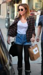 Miley Cyrus WhiteTLunch 6 86x150 Miley Cyrus Goes Braless in a white shirt